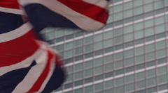 United Nations Building in NYC British Flag Waving Blowing Wind United Kingdom Stock Footage