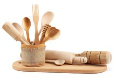 Wooden kitchen utensils isolated on white background. Stock Photos