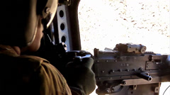 Chinook door gunner fires his machine gun Stock Footage