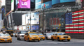 New York City Times Square Driving Car Traffic Taxi Passing Yellow Cab Bus Day Footage