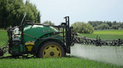 Long farm tractor sprayers for crop fertilizing corn from pests Stock Footage