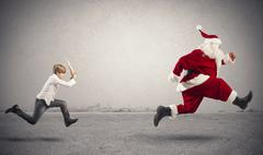 Angry child with santa claus Stock Photos