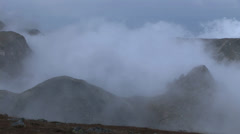 Mist covered sharp peaks Stock Footage
