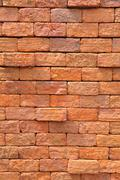 Vintage red brick wall, no smooth line. Stock Photos
