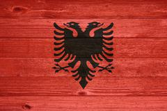 Albania flag painted on old wood plank background. Stock Photos