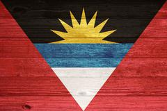 antigua and barbuda flag painted on old wood plank background. - stock photo