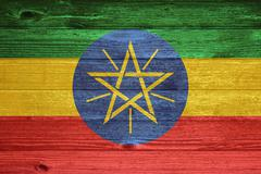 Ethiopia flag painted on old wood plank background. Stock Photos