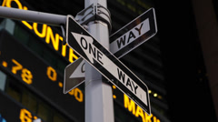 Night Stock Market Shares Ticker Close-up New York City One Way Sign Lights - stock footage