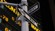 Stock Video Footage of Night Stock Market Shares Ticker Close-up New York City One Way Sign Lights
