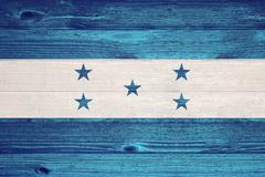honduras flag painted on old wood plank background. - stock photo