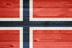 norway flag painted on old wood plank background. - stock photo