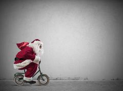 fast santa claus on the bike - stock photo