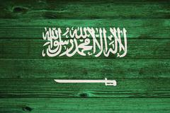 Saudi arabia flag painted on old wood plank background. Stock Photos