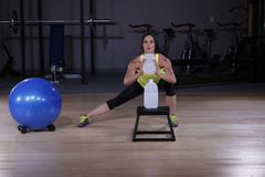Fitness Woman Working Out at the Gym with Water Jugs Stock Photos