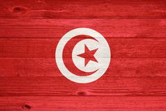 Tunisia flag painted on old wood plank background. Stock Photos