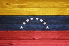 venezuela flag painted on old wood plank background. - stock photo