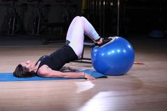 Fitness Woman Working Out at the Gym with Ball - stock photo