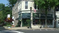 Florist shop on street corner Stock Footage