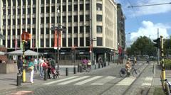 Pedestrians walking across tram tracks in Antwerp, Belgium. Stock Footage