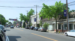 Cars driving down Main Street Stock Footage