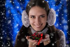 Winter Girl Holding a Christmas Decoration - stock photo