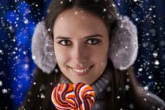 Winter Girl with Lollypop - stock photo
