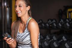 Fitness Woman Texting On Phone Stock Photos