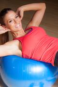 Fitness Woman Sit Up On Ball - stock photo
