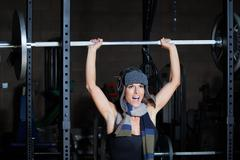 Fitness Woman Lifting Barbell  Stock Photos