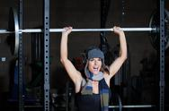 Stock Photo of Fitness Woman Lifting Barbell