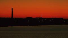 Red sunset over city with an estuary water on a foreground Stock Footage