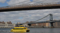 New York Ferry Taxi NYC Downtown Skyline Manhattan Bridge Busy City Commuters US HD Footage