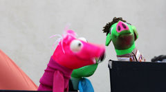 Colored pig puppet dolls perform, theater for childrens - stock footage