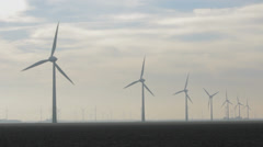 Windmills in a line, wideangle - stock footage