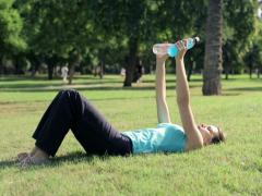 Young woman doing exercise for arms using bottles as a weights NTSC Stock Footage