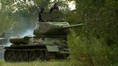 Russian tank drives thru trees Stock Footage