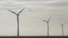 Windmills in a row, wideangle - stock footage