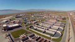Aerial view of sewage treatment plant - stock footage