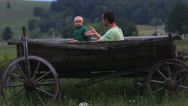 Stock Video Footage of Funny baby son and father shake hands in rustic cart in nature, happy deal