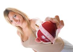 time for diet slimming. woman with apple - stock photo