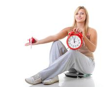 time for diet slimming. large girl with scale. - stock photo