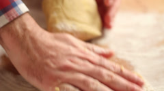 Hands working dough with flour | Handheld side shot Stock Footage