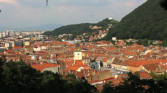 Beautiful urban panorama, medieval town with green mountains Stock Footage
