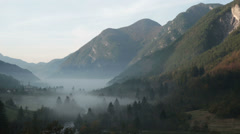 Foggy valley in the Italian Alps | Early morning in Autumn | Panning shot Stock Footage