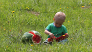 Stock Video Footage of Funny baby eat with pleasure tasty fruit, slice of watermelon in nature