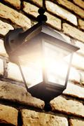 lamp on brick wall - stock photo