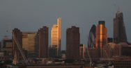 Ultra HD 4K Sunset Corporate Aerial View London City Skyline High Rise Towers Stock Footage
