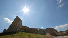 Bright sun shining up on old fortress - stock footage