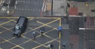 UltraHD 4K London Black Taxi Cab Passing People Crossing Crosswalk Rainy Day UK Stock Footage