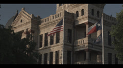 Flags in front of courthouse Stock Footage